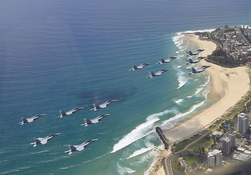 A mass formation of 16 F/A-18F Super Hornets fly's over South East Queensland.