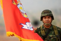 A Royal Thailand Marine holds his Corps' colors during the field training exercise opening ceremony of Exercise Cobra Gold 2011