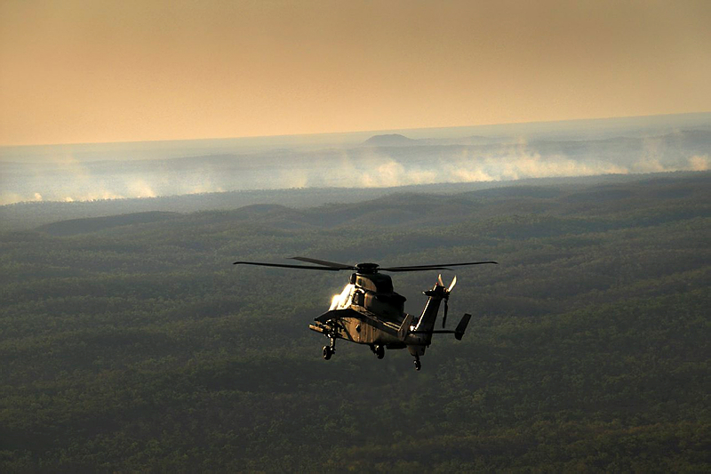 A Tiger ARH from Darwin-based 1st Aviation Regiment observes the target area after the firing of a Hellfire missile in the late afternoon sunlight over the the Mount Bundey Training Area in the Northern Territory.