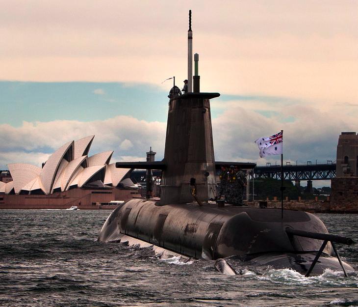 HMAS Dechaineux sails into Sydney Harbour heading for Garden Island.