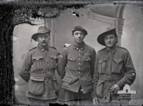 Group portrait of two unidentified Australians with a French soldier. The man on the left also appears in P10550.027. From the Thuillier collection of glass plate negatives. Taken by Louis and Antoinette Thuillier in Vignacourt, France during the period 1916 to 1918.