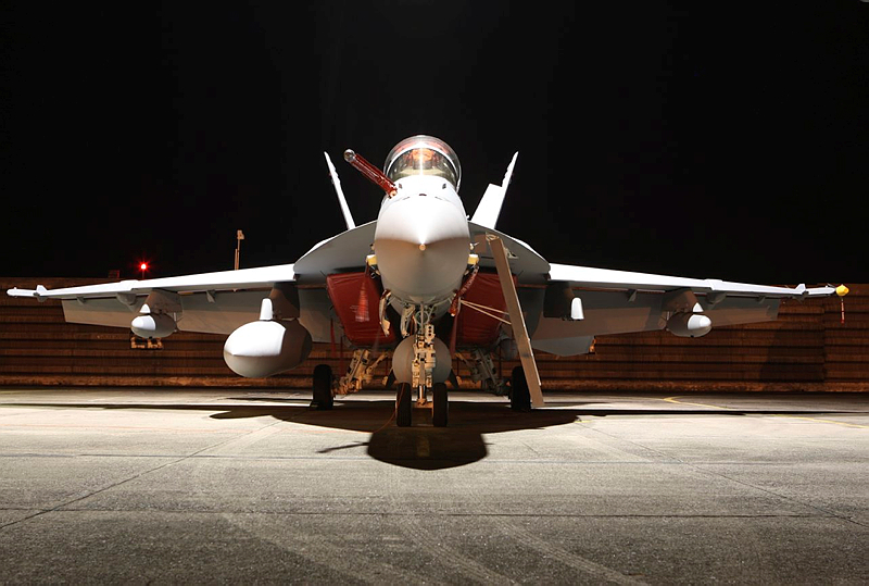 An F/A-18F Super Hornet sits under the night lights of the hangar at RMAF Base Butterworth, Malaysia during Exercise Bersama Shield 2011.
