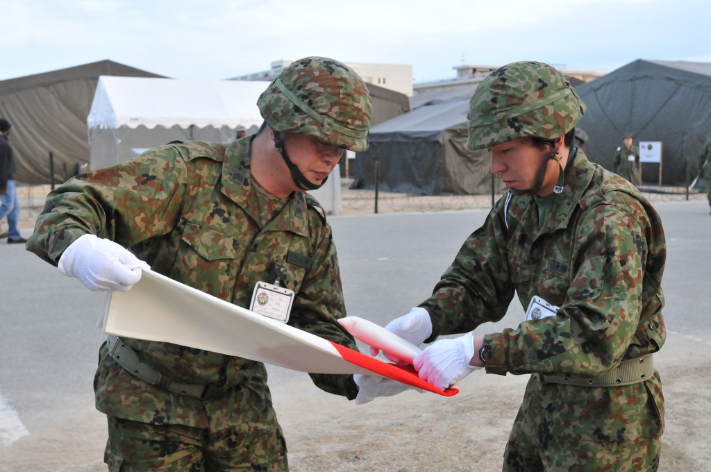 U.S. and Japanese flags were raised and lowered by a joint U.S. and Japanese color guard during Yama Sakura 61 a bilateral command post exercise held at Camp Itami, Osaka, Japan. The final flag was lowered as the exercise ended 4 Feb., 2012.