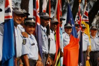 Police from across the Pacific region stand with their countries' flags, at RAMSI's Headquarters in 2007