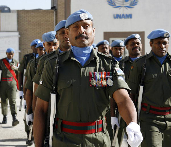 Members of the Fijian colour guard and the guard unit of the United Nations Assistance Mission in Iraq (UNAMI) march. 4/Feb/2009. UN Photo/Rick Bajornas.