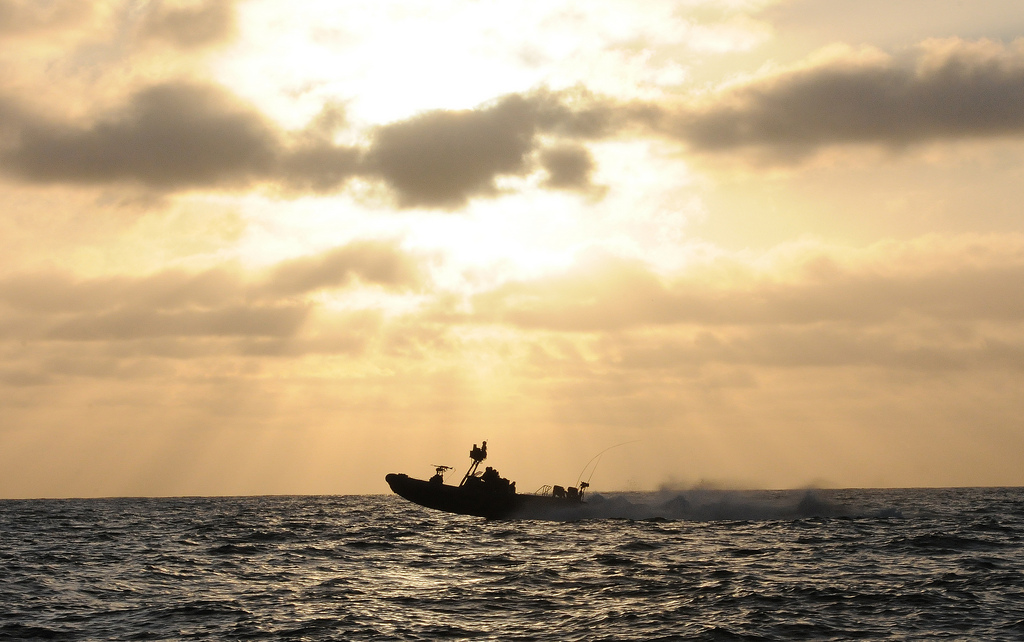 Sailors from a special boat team conduct boat operations supporting a SEAL team during their maritime operation training cycle