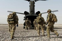 Australian soldiers from the Special Operations Task Group prepare to board a U.S. Army CH-47 Chinook helicopter at Multi-National Base – Tarin Kot, Uruzgan province, southern Afghanistan, as they head out on another mission.