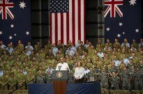 Prime Minister Gillard listening to President Obama addressing troops in Darwin.