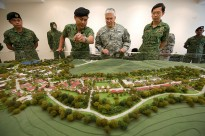 Singaporean army Lt. Col. Jimmy Toh, second from left, briefs Chief of Staff of the U.S. Army Gen. George W. Casey Jr., second from right, about the Murai Urban Warfare Training Facility in Singapore Aug. 26, 2009.