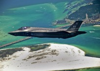 The Department of Defense's first U.S. Air Force F-35 Lightning II joint strike fighter (JSF) aircraft soars over Destin, Fla., before landing at its new home at Eglin Air Force Base, July 14, 2011