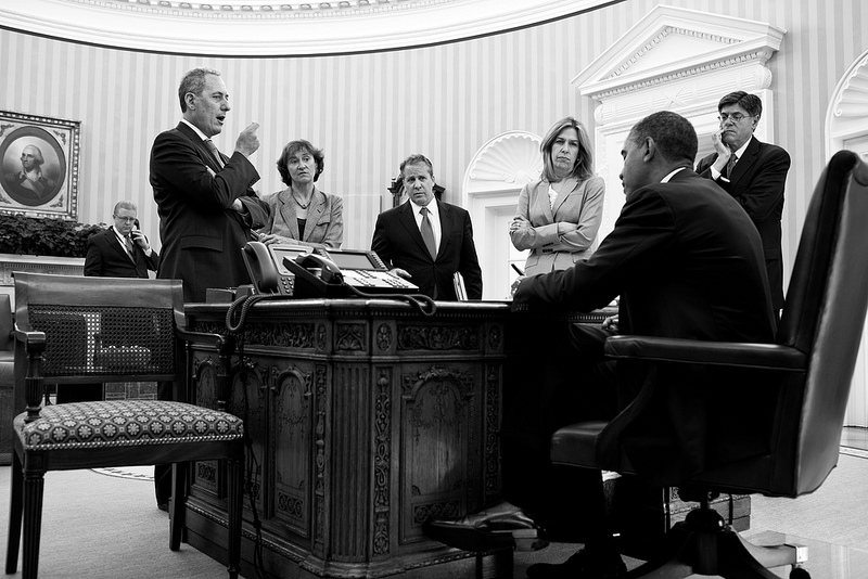 President Barack Obama talks with senior advisors before a phone call with President François Hollande of France in the Oval Office, June 27, 2012.