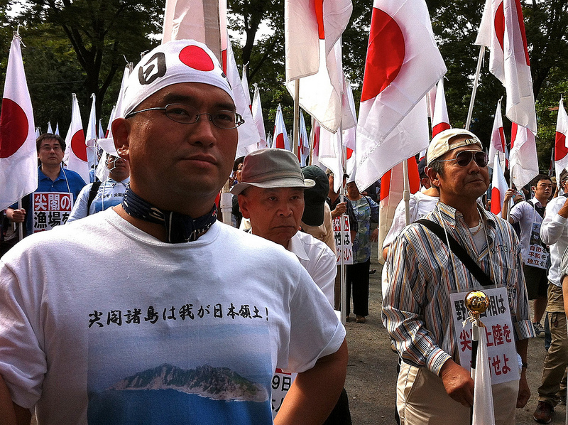 A demonstrator bares a shirt declaring the Senkaku/Diaoyu islands as Japanese territory. Nationalist group 'Ganbare Nippon' has seized on the issue as an example that Japan needs to enact a tougher foreign policy position towards China and its recent 'aggression'.