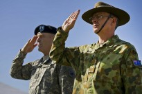 Maj. Gen. Roger F. Mathews Deputy Commanding General U.S. Army, Pacific (USARPAC) and Australian Defense Force Maj. Gen. Richard M. Burr, Headquarters U.S. Army Pacific Deputy Commanding General of Operations salute as the US and Australian National Anthems are played during a Jan. 17, 2013 Deputy Commanding General flying V Ceremony at the Historic Palm Circle on Fort Shafter, Honolulu, Hawaii. The ceremony held to welcome Burr and his family as the first foreign military officer to be assigned at this level of leadership in the U.S. Army. Burr's appointment as the USARPAC Deputy Commanding General of Operations signifies the continuing strong relationship between the United States and Australia and further shows the support by both countries for the National strategy of ensuring stability and security throughout the Pacific Region. (Department of Defense photo by U.S. Air Force Tech. Sgt. Michael R. Holzworth/Released)