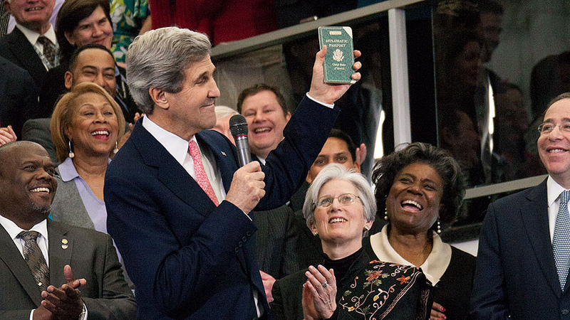 U.S. Secretary of State John Kerry displays his first diplomatic passport, while delivering welcome remarks to U.S. Department of State employees in Washington, D.C., February 4, 2013.