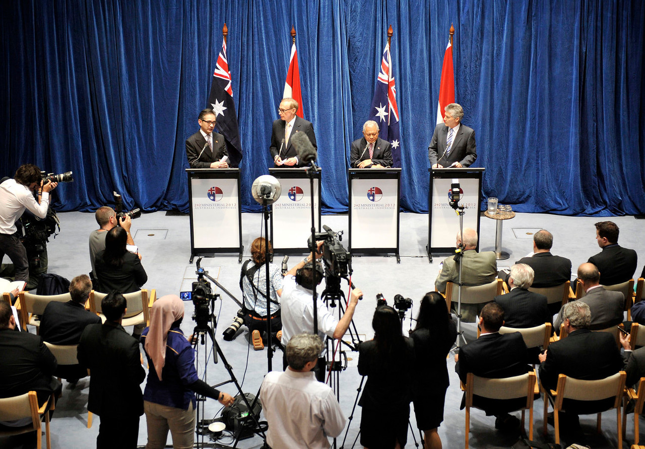 Room for one more? Senator the Hon Bob Carr, HE Dr Marty Natalegawa (Indonesian Foreign Minister), HE Dr Purnomo Yusgiantoro (Indonesian Defence Minister) and Defence Minister Stephen Smith address media following the inaugural Australia-Indonesia 2+2 Ministerial Dialogue in Canberra on 15 March 2012.