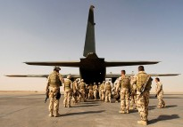 Soldiers from Combat Team Waler board the C-130 Hercules at Ali Air Base, Tallil Iraq for the first stage of their journey home to Australia.