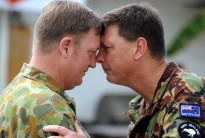 The new International Stabilisation Force Commander, Colonel Mick Reilly and the Deputy Commander International Stabilistaion Force, Commander Tony Miller exchange a Hongi during the traditional Powhiri ceremony held in East Timor.