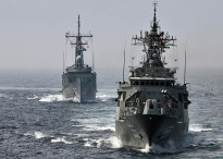 The Royal Australian Navy Adelaide-class guided-missile frigate HMAS Sydney (FFG 03) and the Anzac-class frigate HMAS Ballarat (FFH 155) conduct formation maneuverings in the Atlantic Ocean July 17, 2009.