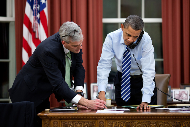 President Barack Obama confers with Chief of Staff Denis McDonough as he talks on the phone in the Oval Office, Feb. 6, 2013.