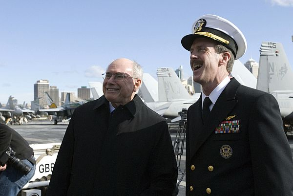 SYDNEY, Australia (July 5, 2007) - Rear Adm. Rick Wren, commander of Carrier Strike Group 5, and Australian Prime Minister John Howard talk about flight operations while touring the flight deck aboard USS Kitty Hawk.