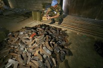 A United Nations peacekeeper from the Indian battalion of the United Nations Organization Mission in the Democratic Republic of the Congo (MONUC) examines AK-47 magazines stored in a warehouse in Beni, where all weapons and ammunition are stored after they have been collected in the demobilization process in Matembo, North Kivu, in the Democratic Republic of the Congo.
