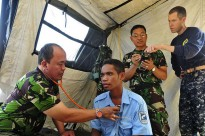 Maj. I Gede Putu Arsana of the Indonesia Army, examines a patient. Dili, Timor-Leste, June 19, 2011.