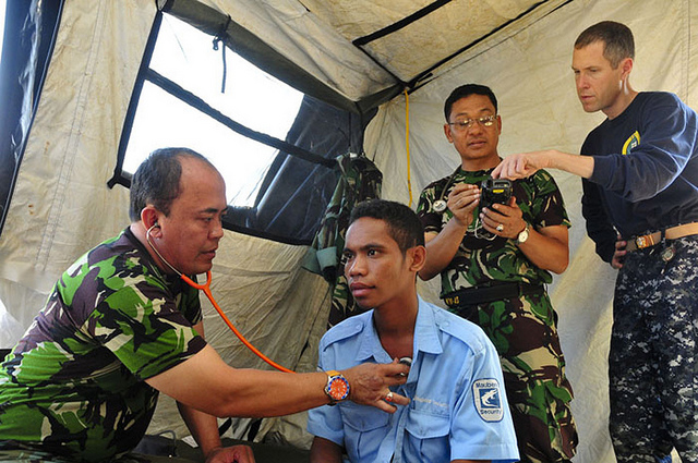 Maj. I Gede Putu Arsana of the Indonesian Army examines a patient in Dili, Timor-Leste, June 19 2011.