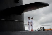 Chinese People's Liberation Army-Navy sailors stand watch on the submarine Yuan at the Zhoushan Naval Base in China on July 13, 2011.