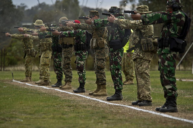 Service Members from Indonesia, Australia, United States, and United Kingdom fire 9mm pistols during an international shooting match at the 2012 Australian Army Skill at Arms Meeting (AASAM) May 9 in Puckapunyal, Australia.