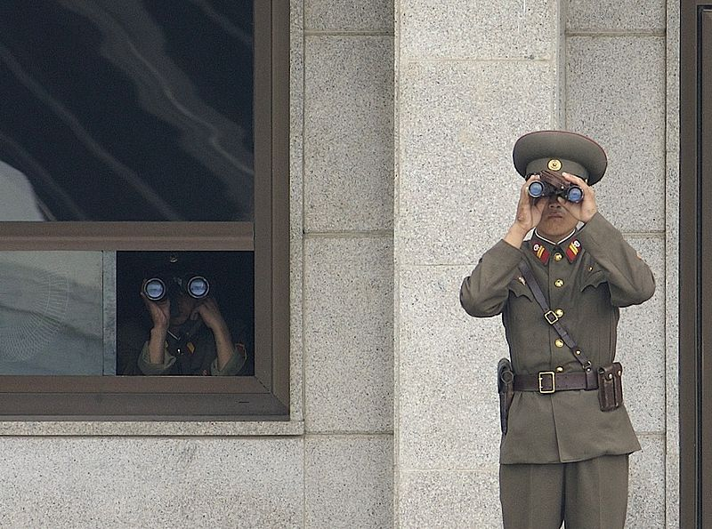 Soldiers from the Korean People's Army look south while on duty in the Joint Security Area