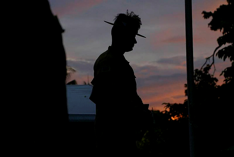 LCPL Dustin Hoppe from Melbourne's 4th/19th Prince of Wales Light Horse Regiment stands at Rest on Arms as a member of the Catafalque Party during the Dawn Service in Honiara, Solomon Islands.