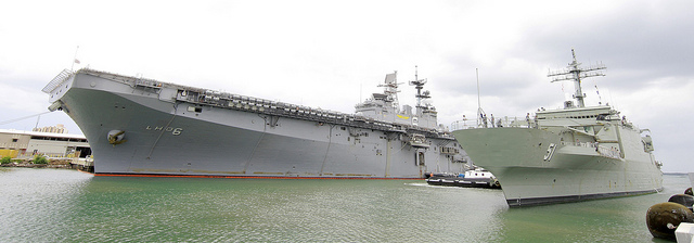 PEARL HARBOR (June 28, 2010) The Royal Australian Navy amphibious landing platform HMAS Kanimbla (L 51), moors alongside the amphibious assault ship USS Bonhomme Richard (LHD 6) at Joint Base Pearl Harbor-Hickam to participat in Rim of the Pacific (RIMPAC) 2010 exercise. RIMPAC is a biennial, multinational exercise designed to strengthen regional partnerships and improve interoperability. (Royal Australian Navy photo by ABIS Dove Smithett/Released)