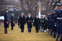 Army Colonel David Anders escorts President Barack Obama and President Hu Jintao of China as they review the troops on the South Lawn of the White House, Jan. 19, 2011. (Official White House Photo by Lawrence Jackson)