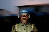 Portrait of a Nigerian peacekeeper with the United Nations-African Union Hybrid Mission in Darfur (UNAMID) as he and his battalion prepare for a night patrol through Internally Displaced Persons (IDP) camps in El Geneina, the state capital of West Darfur, Sudan.