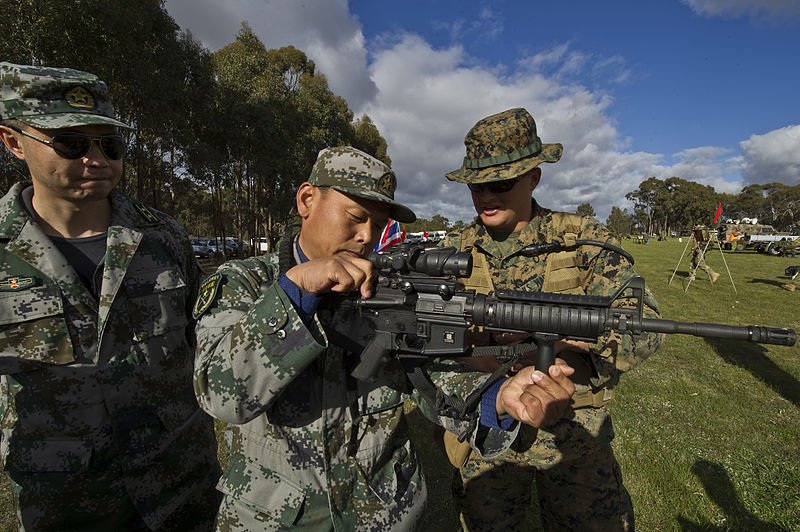 Chinese People's Liberation Army officers with the Beijing Military Region speak with U.S. Marine Corps Staff Sgt. Travis W. Hawthorne, right, about the M4 carbine during the 2012 Australian Army Skill at Arms Meeting (AASAM) in Puckapunyal, Australia, May 12, 2012.