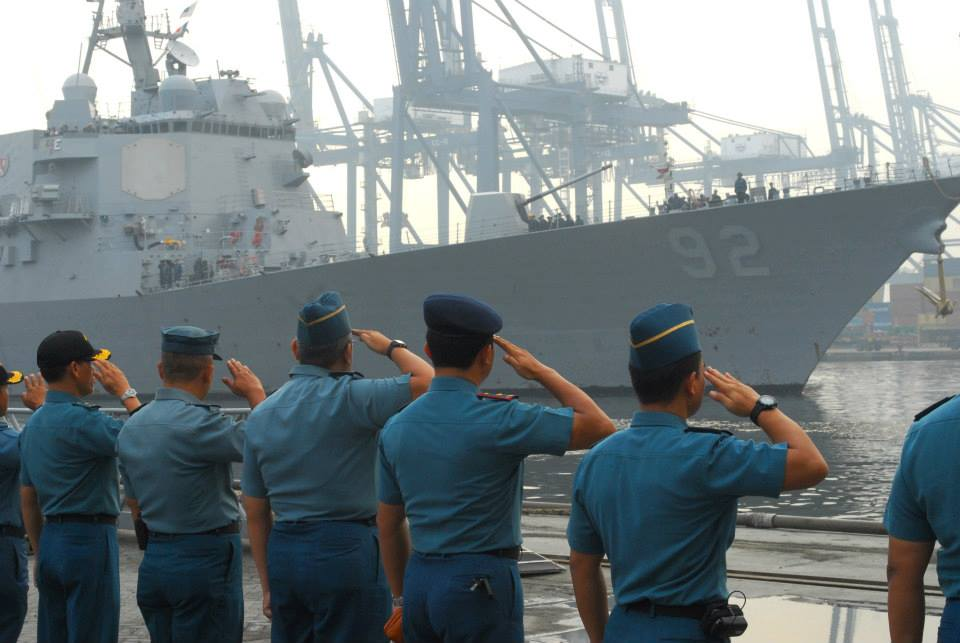 Republic of Indonesia Sailors render honors as the guided missile destroyer USS Momsen (DDG 92) arrives in Jakarta, Indonesia. Momsen, along with more than 1,000 Sailors and Marines are participating in Cooperation Afloat Readiness and Training (CARAT) Indonesia 2013.