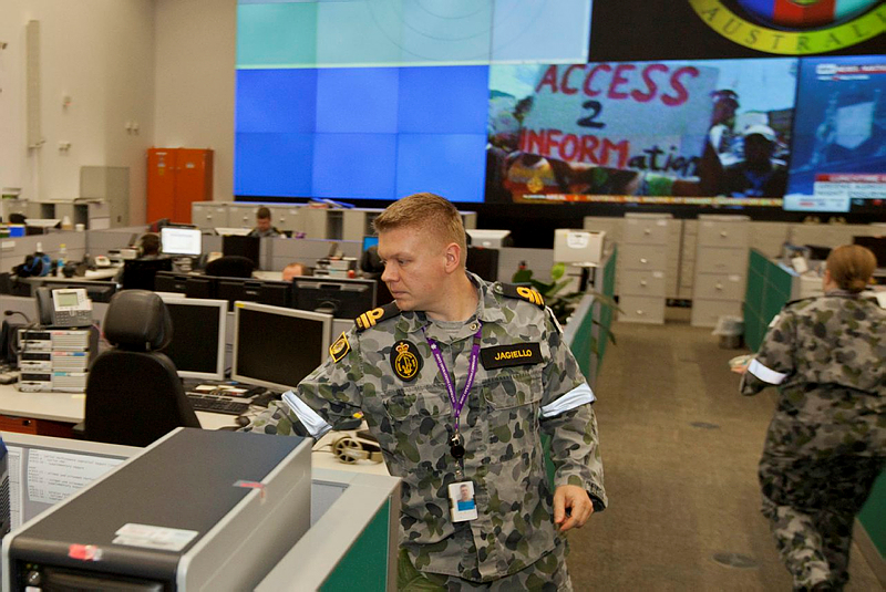 Navy Lieutenant Arthur Jagiello goes about his work in the Joint Control Centre of Headquarters Joint Operations Command (HQJOC), Bungendore.