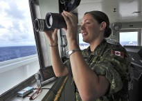 PACIFIC OCEAN (Aug. 27, 2012) - Canadian Navy Lt. Lois Lane assists with lookout duties in the pilothouse of Military Sealift Command hospital ship USNS Mercy (T-AH 19) as Mercy transits back to San Diego after completing a four and a half month mission. Pacific Partnership, an annual U.S. Pacific Fleet humanitarian and civic assistance mission now in its seventh year, brings together U.S. military personnel, host and partner nations, non-government organizations and international agencies to build stronger relationships and develop disaster response capabilities throughout the Asia-Pacific region. (U.S. Navy photo by MC2 Roadell Hickman)