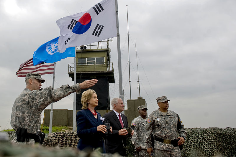 Secretary of State Hillary Clinton and Secretary of Defense Robert M. Gates look out over North Korea