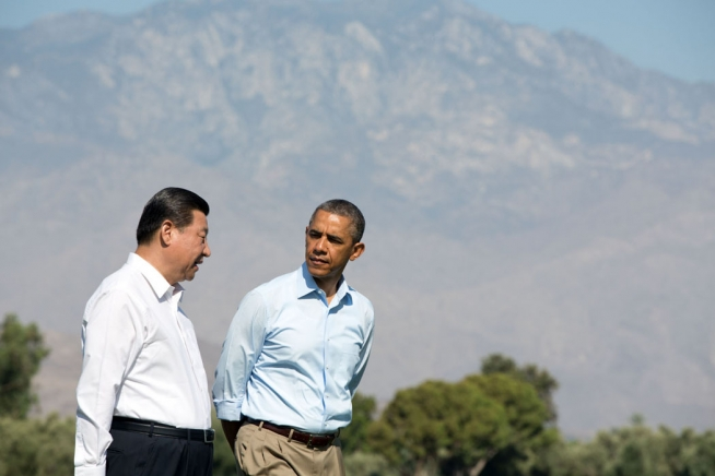 President Barack Obama walks with President Xi Jinping of the People's Republic of China on the grounds of the Annenberg Retreat at Sunnylands in Rancho Mirage, Calif., June 8, 2013. (Official White House Photo by Pete Souza)