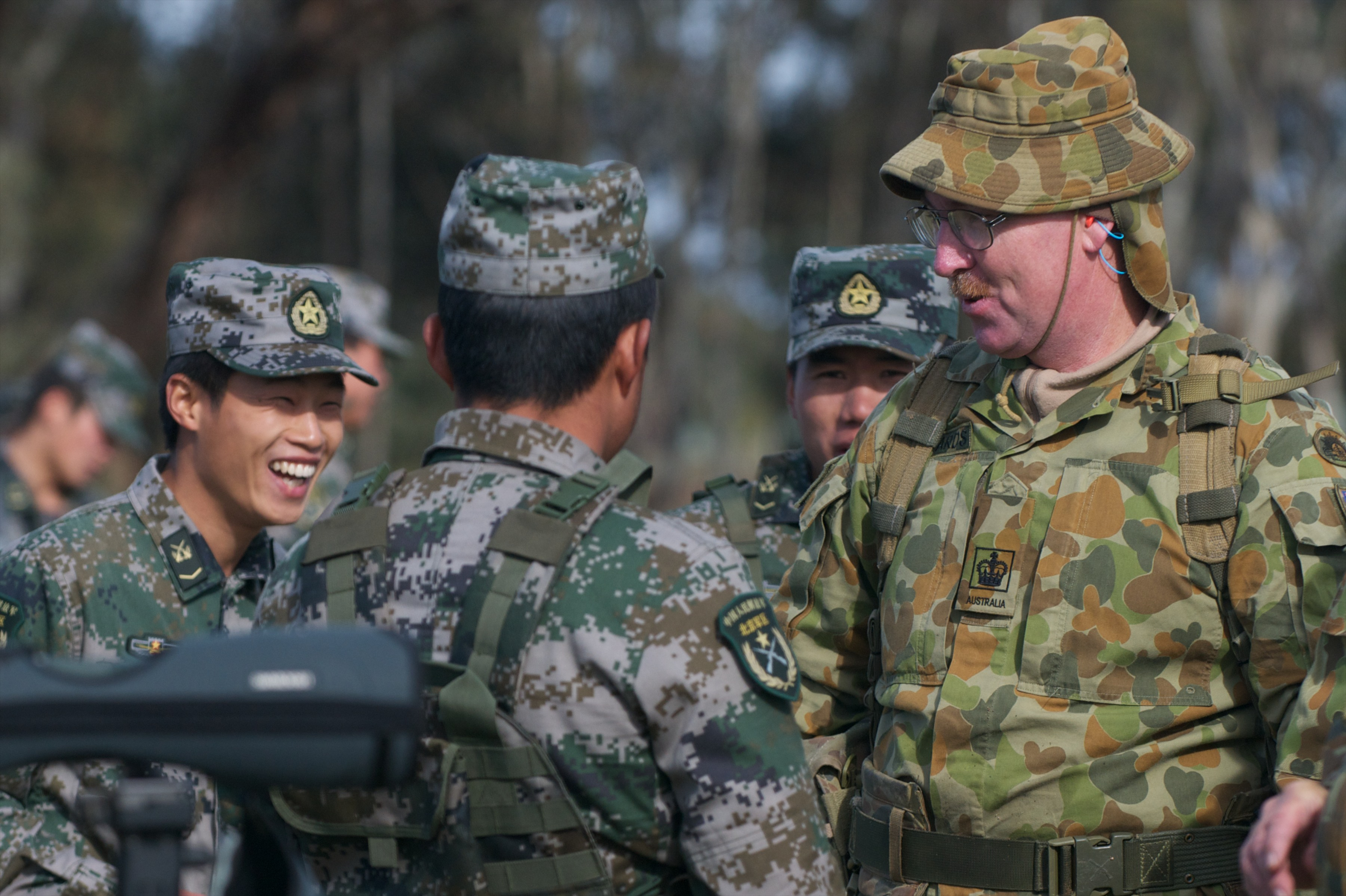 International teams enjoy some time together during Match 62 – International Service Rifle Championship on the last day of competition at this year's Australian Army Skill at Arms Meeting (AASAM).  Warrant Officer Class Two Peter Richards of the Operations Support Squadron, 6th Engineer Support Regiment, jokes with shooting team members from China.