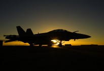 An F/A-18F Super Hornet catches the early morning rays of a Territory sunrise on the flightline at RAAF Base Darwin.
