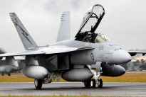 A F/A-18F Superhornet taxis in after the simulated strike on RAAF Base Williamtown.
