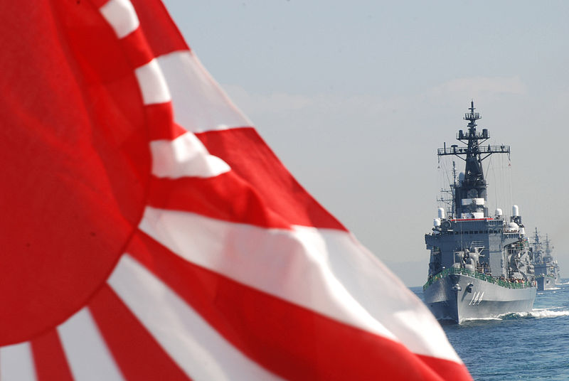he Japan Maritime Self-Defense Force helicopter destroyer JS Kurama (DDH-144) leads ships during a rehearsal for the 2009 fleet review.