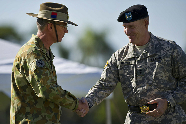 FORT SHAFTER, Hawaii (Jan. 17, 2013) - Maj. Gen. Roger F. Mathews Deputy Commanding General U.S. Army, Pacific (USARPAC) welcomes Australian Defense Force Maj. Gen. Richard M. Burr, Headquarters U.S. Army Pacific Deputy Commanding General of Operations during a Deputy Commanding General flying V Ceremony at the Historic Palm Circle. The ceremony held to welcome Burr and his family as the first foreign military officer to be assigned at this level of leadership in the U.S. Army. Burr's appointment as the USARPAC Deputy Commanding General of Operations signifies the continuing strong relationship between the U.S. and Australia and further shows the support by both countries for the National strategy of ensuring stability and security throughout the Pacific Region. (Department of Defense photo by U.S. Air Force Tech. Sgt. Michael R. Holzworth)  130117-F-MQ656-177