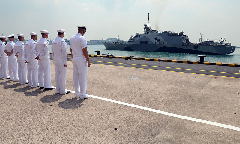 SINGAPORE (Apr. 18, 2013) - Sailors attached to Forward Liason Element, USS Freedom (LCS 1), observe Freedom as it arrives in Singapore during an eight-month deployment to Southeast Asia. Fast, agile, and mission focused, LCS platforms are designed to employ modular mission packages that can be configured for three separate purposes: surface warfare, mine countermeasures, or anti-submarine warfare. Freedom will remain homeported in San Diego throughout this deployment to Southeast Asia.