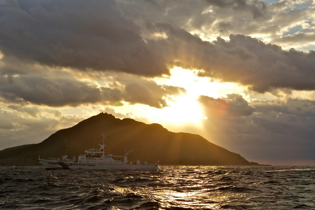 A Japanese Coast Guard patrol vessel passes by Uotsuri, the largest island in the Senkaku/Diaoyu chain.