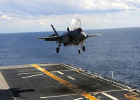 ATLANTIC OCEAN (Oct. 3, 2011) An F-35B Lightning II makes the first vertical landing on a flight deck at sea aboard the amphibious assault ship USS Wasp (LHD 1). The F-35B is the Marine Corps Joint Strike Force variant of the Joint Strike Fighter and is designed for short takeoff and vertical landing on Navy amphibious ships. (U.S. Navy photo by Mass Communication Seaman Natasha R. Chalk/Released)
