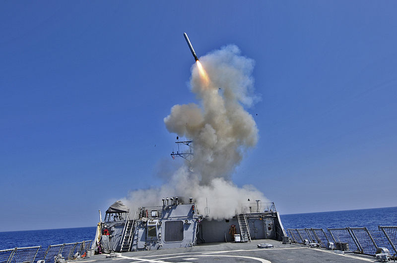 An American Arleigh Burke-class guided-missile destroyer launches a Tomahawk cruise missile in the Eastern Mediterranean.