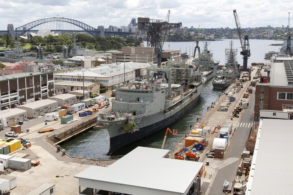 Captain Cook Dock at Garden Island, Fleet Base East in early March 2013 with the Sydney Harbour Bridge and the Opera House in the background.